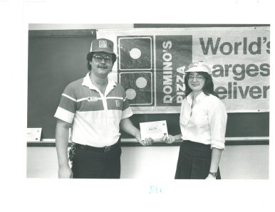 "Jennifer Paulin, 1987 Forest Parker and Trinity High School Senior accepts the certificate for Best high school entry to the Domino's Pizza state championship ""Count on Domino's."""