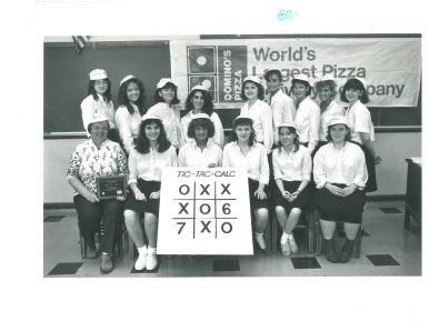 Trinity High School senior class of 1987 with their calculus game, Tic-Tac-Calc.