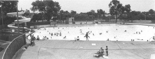 This is an overview of the Forest Park Pool in 1994, notice the splash pad and in pool play ground have not been added to the pool.
