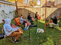 Daniel Gasse, of the Gasse School of Music, teaches group cello lessons in his backyard. | Photo by Jason Maxham