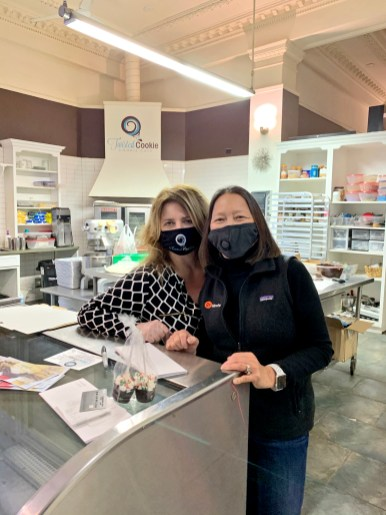 Susie Goldschmidt (left) surprised Twisted Cookie owner Joana Fischer Thompson with a visit and purchase from Byline Bank | Photo provided