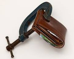 brown wallet being clamped