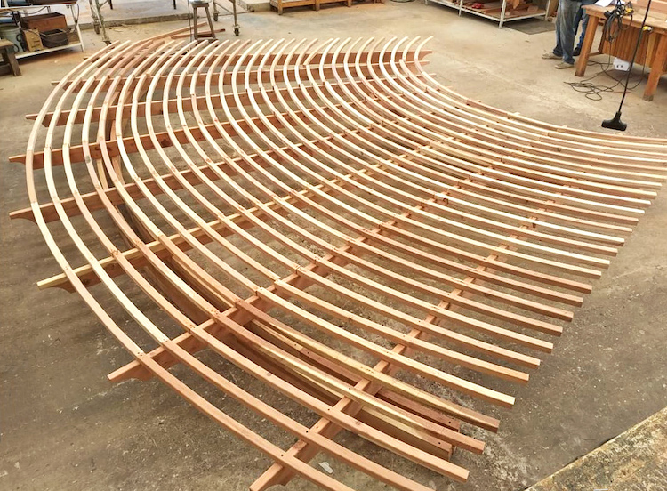 A fan-shaped pergola roof in construction at Forever Redwood's woodworking shop.