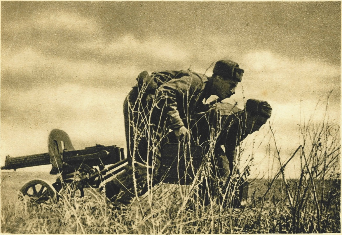 Soldiers pulling a Russian 1910 Maxim into position on a wheeled Sokolov mount
