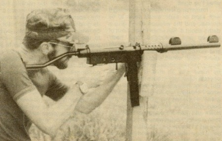 Author firing a suppressed Uru SMG