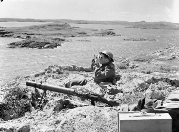 Soldier of the Black Watch guards a beach with a Lewis LMG