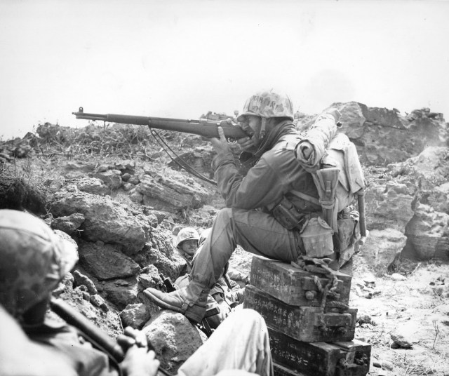 American marine aiming an M1 Garand on Iwo Jima