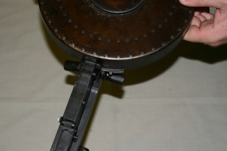 Rotating the magazine to lock it in place (2/4)