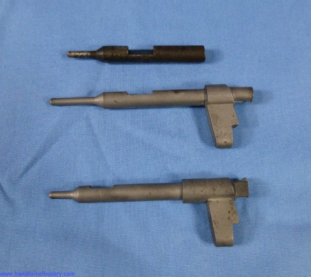 "The remnants of the original firing pin above two replacements obtained from the Rifle Shop.  The original is a better match to the ""old style"" pin."