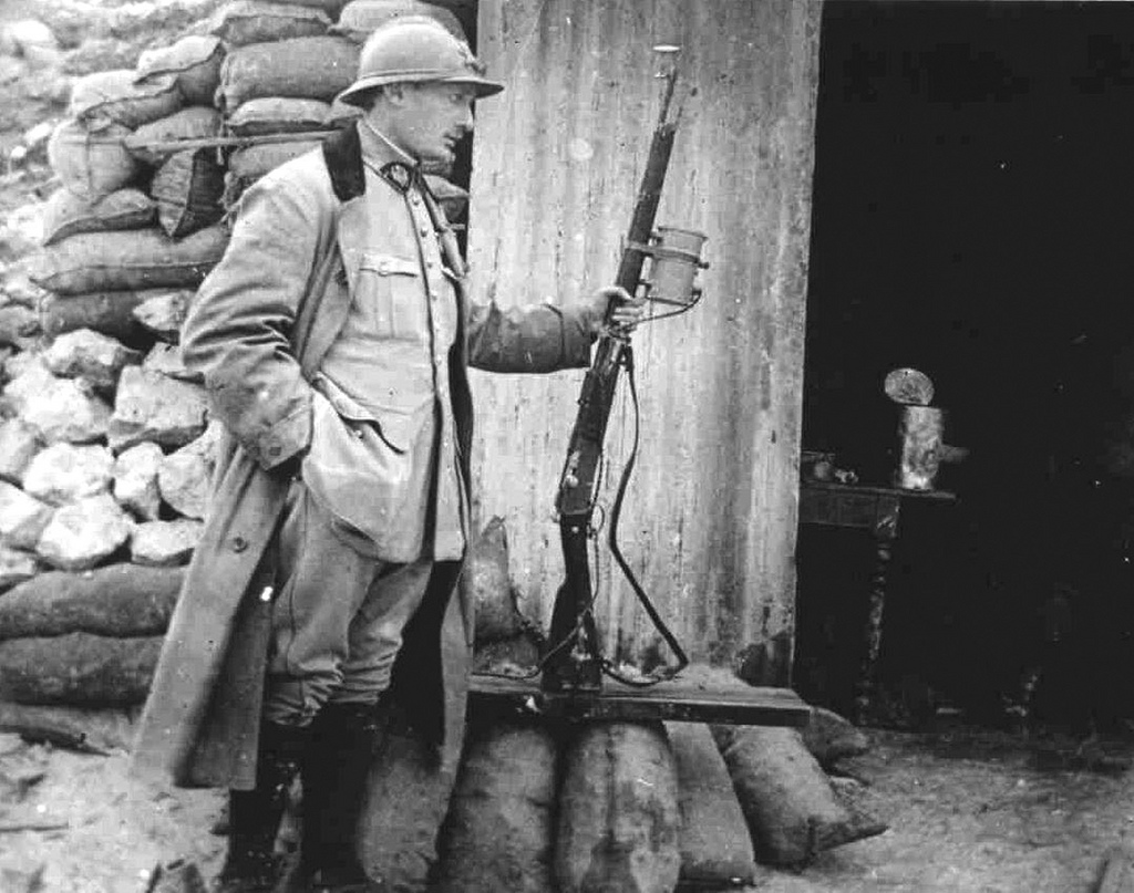 French officer with a Lebel rifle with mounted light