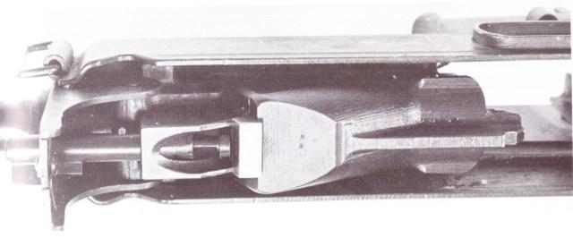 Horn rifle piston in the unlocked position