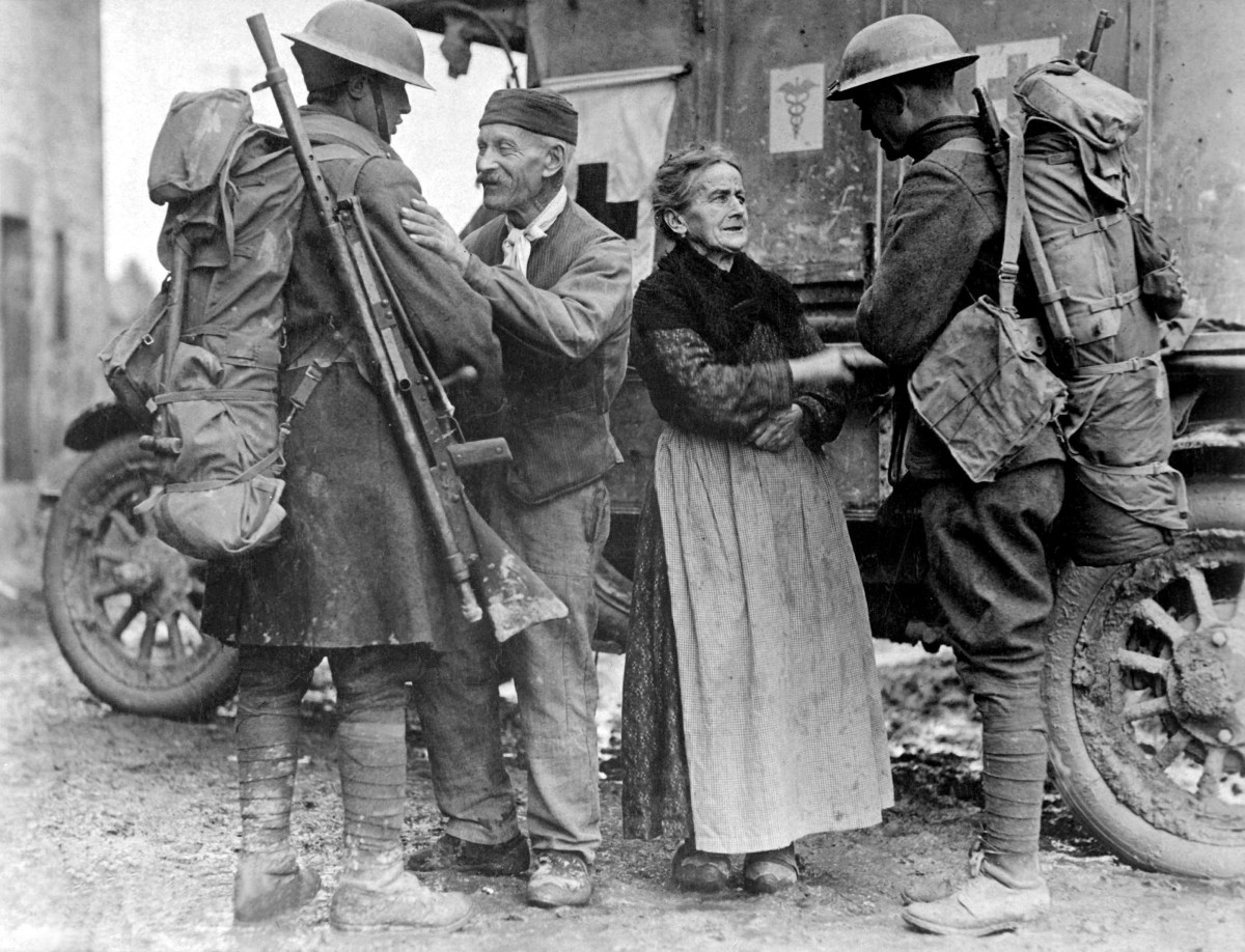 An old  French couple, M. and Mme. Baloux of Brieulles-sur-Bar, France, under German occupation for four years, greeting soldiers of the 308th and 166th Infantries upon their arrival during the American advance.  November 6, 1918.