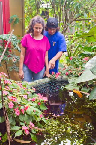 Felicia and Ian at the tilapia pond. Photo by Keri Cooper