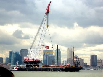 It was followed by the large crane used to lift it onto the Intrepid.