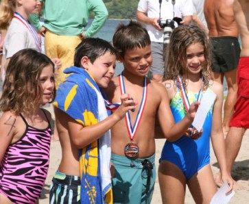 Winning swimmers show medals at Hanalei