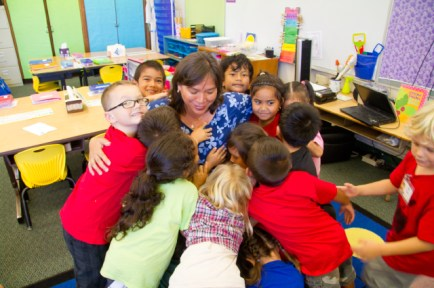 Debbie Lindsey surrounded by first graders. Photo by Keri Cooper