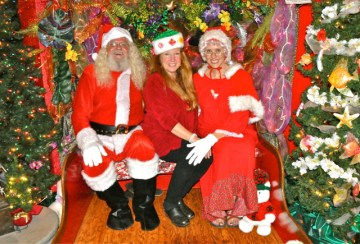 The Clauses and the Festival of Lights lady, 2011. L-R: Michael Patton as Santa; Elizabeth Freeman, festival head; and Jewels Tidwell as Mrs. Claus. Cover photo by Danny Hashimoto