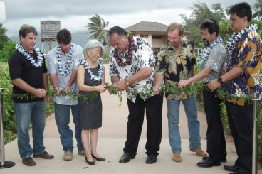 Officials untie the maile lei during the blessing of 3 new segments of Ke Ala Hele Makalae, Kaua'i's multi-use path. From left: Steve Baginski, president and CEO, Kaikor Construction Co.; Bill McCune, project manager, Earthworks Pacific, Inc.; Council member JoAnn Yukimura; Mayor Bernard Carvalho, Jr.; Jeff Fisher, president, Earthworks Pacific, Inc.; Steve Kyono, vice president and Kaua'i office manager, SSFM International, Inc.; and Parks and Recreation Director Lenny Rapozo.