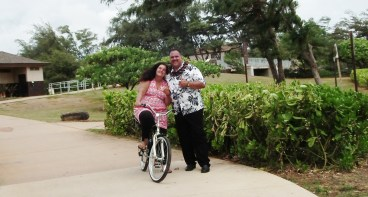Kapa'a resident Ann Punohu stops to talk story with Mayor Bernard Carvalho, Jr. during the celebration of the completion of 3 new segments of Ke Ala Hele Makalae, Kaua'i's multi-use path. Seeking a healthier lifestyle, Punohu sold her truck about three months ago and bought a bicycle, and now uses the coastal path for most of her travels between Wailua and Keālia.