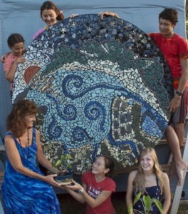 LaVerne Bishop, Executive Director of Hale `Opio Kaua`i, Inc., Ka`onohi Perry, Astrid Andersson, Evan Young, Kari Whitworth and Aliana Ho. Fifty-five youth were led by Kathleen Ho to create the mosaic of pre-harbor Nawiliwili Bay. It hangs at the entrance of Nawiliwili Small Boat Harbor in front of the Yacht Club. Photo by Kathleen Ho