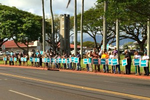 Supporters of Mayor Bernard Carvalho Jr. are seen here holding signs on Rice Street in Lihu'e Thursday.