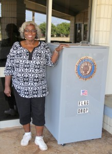 Charlene Dorsey, Junior Vice Commander of Kaua'i Veterans Center, shows a bin in front of KVC in Lihu'e, where old U.S. flags can drop off to be respectfully burned.