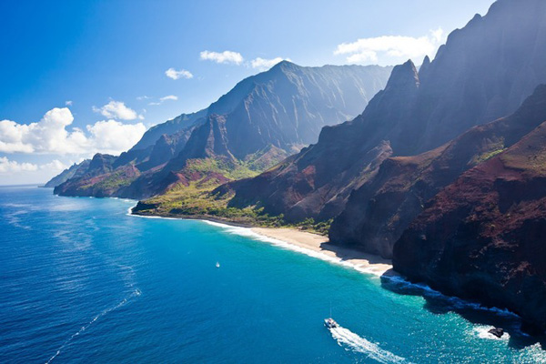 Kalalau Beach on Kaua'i's Na Pali Coast is only accessible by boat or through an 11-mile hike recommended to experienced hikers only. Photo courtesy of Hawai'i Tourism Authority/Tor Johnson