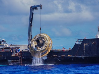 Hours after its successful engineering flight, the first test vehicle for NASA's Low-Density Supersonic Decelerator project is lifted aboard the recovery vessel Kahana.
