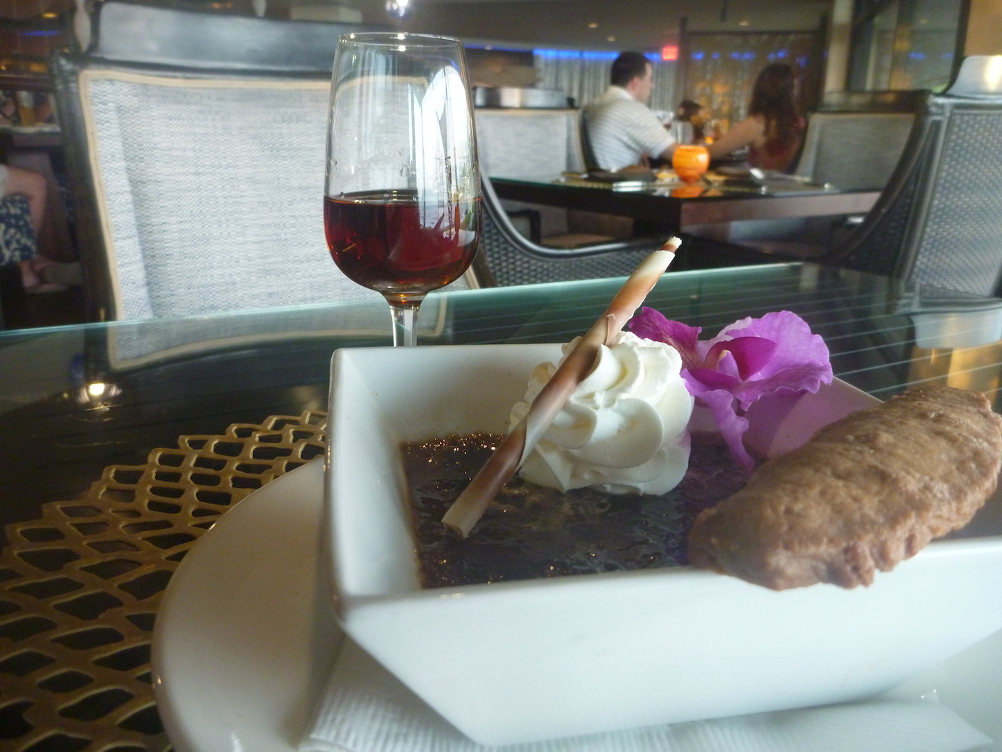 For dessert, Kaua'i Coffee Creme Brûlée, served with a cinnamon biscotti and a thick layer of sugar. Paired with the Zaya Guatemalan rum.