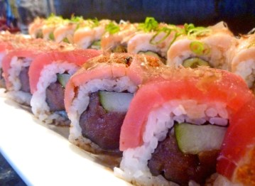 The Bushido and the Butter Me Up rolls are for ahi lovers. The Bushido, topped with dried smoked fish flakes, is a bit spicy, but still keeps it cool due to the ginger-marinated ahi. The Butter Me Up has salmon on the top, torched butter drizzling down the roll, and is filled with warm and sweet mac nut-crusted ahi.