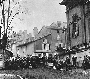 Soldiers of the 353rd Infantry near a church at Stenay, Meuse in France, wait for the end of hostilities. This photo was taken at 10:58 a.m., on Nov. 11, 1918, two minutes before the armistice ending WWI went into effect.