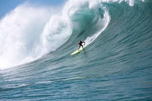 Kaua'i's Evan Valiere is seen here riding down the face of a large wave in Peahi, Maui.