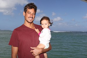 Big-wave charger Evan Valiere and his daughter, Jaya, in Hanalei mid-November.