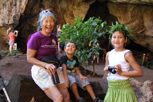 Suzanne Kashiwaeda and grandson Adrien Smith, with 'Anonui Emery in the Makauwahi Sinkhole.