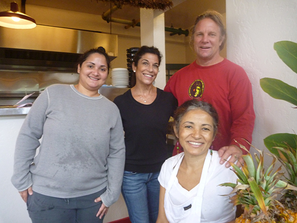 Neide, front row, and her staff will treat you like family.