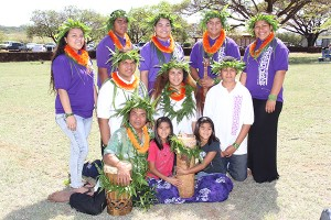 Kumu hula Kaua'i Iki, seated, and his students from Kapa Kanaenae O Kaua'i Iki halau.