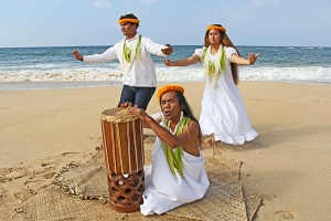 Kumu hula Kaua'i Iki is seen here with two of his students from Ni'ihau, Kilolani Kanahele and Kapua Kelley-Kanahele, performing at Kekaha Beach.