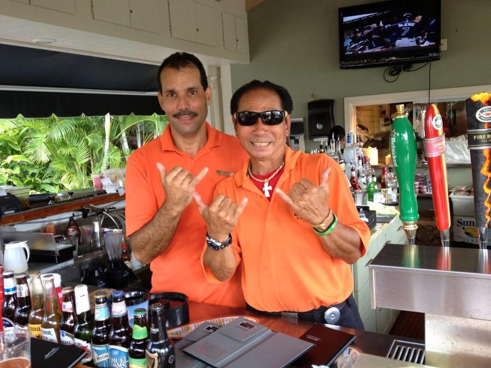 Richard Duarte, left, and Kurt Javinar working at Kalapaki Grill at the Kaua'i Marriott Resort and Beach Club.