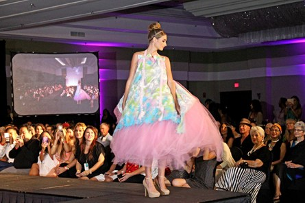 A model wears an outfit created by Louda Larrain.