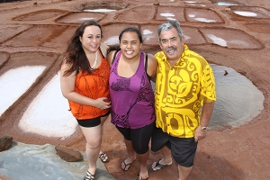 Frank Santos, with his daughter, Kuulei Santos, and his granddaughter, Waileia Siale-Santos, at the Hanapepe salt beds, where they return every summer to harvest sea salt. Photo by Léo Azambuja
