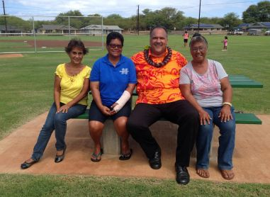 """Mayor Bernard Carvalho, Jr. and the """"aunties"""" who plan to keep an eye on the newly improved Kekaha Gardens' Kaleimanu Park pause for a few minutes to enjoy the picnic area. From L to R: Julie Patricio; Mercy Lazaro; Mayor Carvalho; and Lu Koerte."""