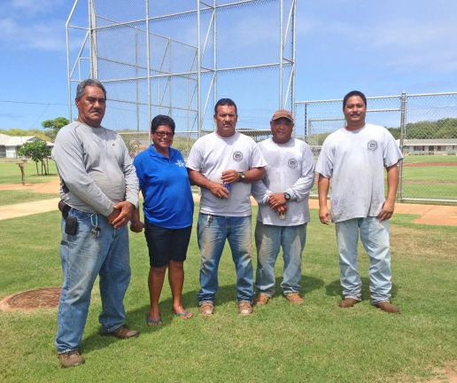 The Westside crew for the Department of Parks and Recreation take time out to pose for a photo before returning to their park caretaker duties. From L to R: Charlie Kaliloa; Mercy Lazaro; Teddy Perreira; Michael Lazaro; and Gilbert Serraon.