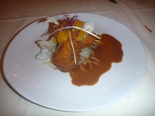 Pork Jowl Tonkatsu served with caracara orange on a fennel salad and a sauce of buttermilk oyster miso hoisin. The batter is crispy, the oranges are tangy, the sauce savory and the fennel slightly bitter; a winning combination.