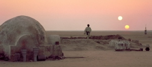 Luke Skywalker gazes at Tatooine's two suns in Star Wars IV. Photo courtesy of Star Wars