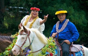 Helen Leilani Santiago, playing Queen Emma, is seen here riding into Kanaloahululu Meadow in Koke'e alongside Harrom Kaili, representing his great-grandfather, Kaluahi, during the Eo e Emalani i Alaka'i in October 2014.