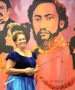 Nalani Brun, who will be portraying Queen Emma at the Eo e Emalani i Alaka'i, is seen here by a painting of the queen's husband, King Kamehameha IV, in the Ali'i Room of Aston Aloha Beach Hotel in Wailua.
