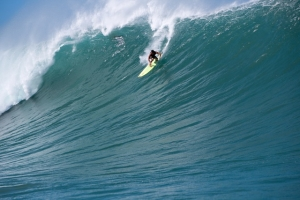 Kaua'i's Evan Valiere is seen here riding a large wave at Himalayas, O'ahu. Photo by Kanoa Zimmerman