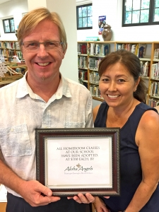"""Kalaheo Principal Erik Burkman and kindergarten teacher Sharlyn Kanna display a certificate stating, """"All homeroom classes at our school have been adopted, at $700 each, by Aloha Angels: Philanthropists Partnering for a More Perfect Kaua'i."""" Contributed photo"""