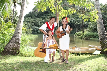Musician Larry Rivera is seen here with his daughter, musician Ilima Rivera, and great granddaughter Hilina'i Kananiokamahina Kahaunaele at Kamokila Hawaiian Village on the banks of Wailua River.