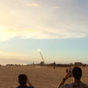 Onlookers at Kekaha Beach Park watch as the orbital rocket carrying a University of Hawai'i payload is launched from PMRF Tuesday.